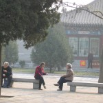Two Women Sitting on a Park Bench Talking on www.adventuresinexpatland.com