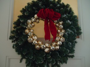 Holiday wreath with jingle bells and red bow www.adventuresinexpatland.com