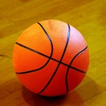 Photo of a basketball sitting on a basketball court at www.adventuresinexpatland.com