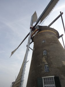 photo looking up at a tall windmill on www.adventuresinexpatland.com