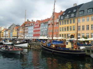 Brightly colored buildings & boats in Copenhagen www.adventuresinexpatland.com