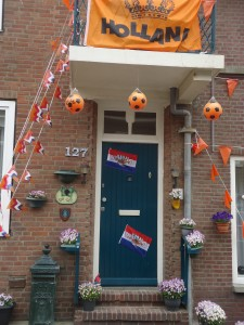 Typical Dutch house decorated for national voetbal game at www.adventuresinexpatland.com