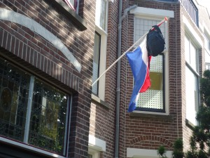 Backpack on Dutch flagpole at www.adventuresinexpatland.com