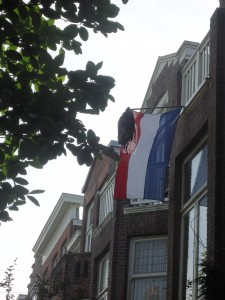 Dutch flagpole with backpack at Adventures in Expat Land