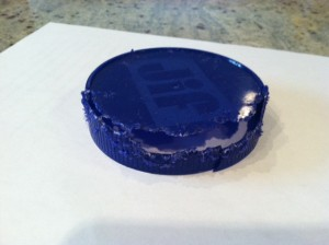 Bright blue plastic jar lid chewed up by a squirrel at Adventures in Expat Land